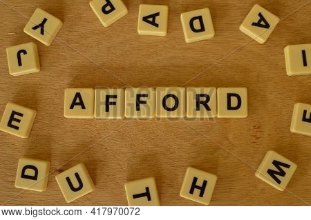 Top View Of Square Letters With Text Afford.