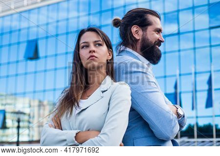 Business Couple Of Man And Woman Outdoor Back To Back, Confrontation