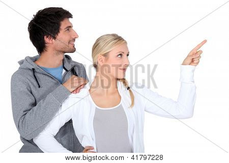 Couple pointing object