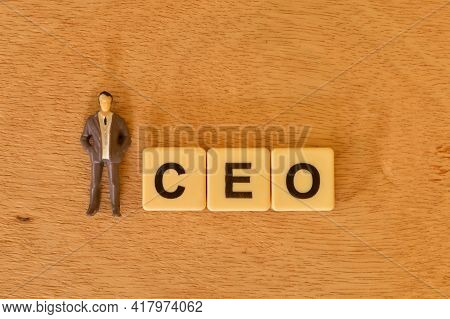 Top View Of People Miniature And Square Letters With Text Ceo Stands For Chief Executive Officer