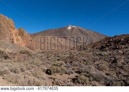 View Of Roques De García Unique Rock Formation With Famous Pico Del Teide Mountain Volcano Summit In