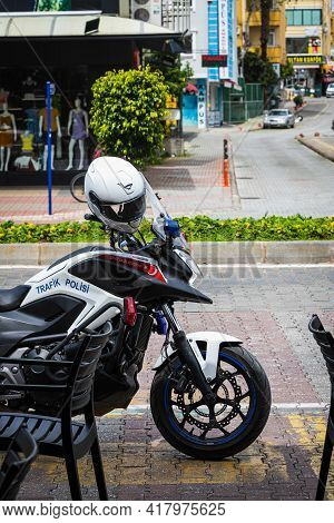 Alanya, Turkey - April 12 2021: Close-up Of Motorcycle Policeman With Helmet On City Street Backgrou