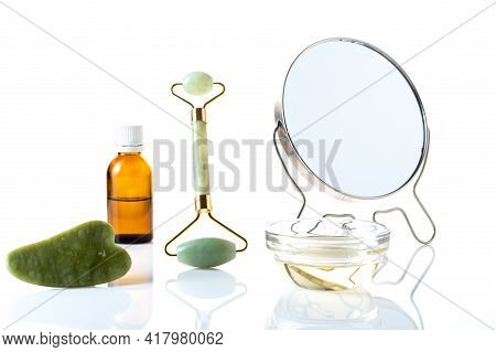 Mirror And Cosmetic Accessories. Do A Facial Massage. Body Skin Care And Wore. Isolated.