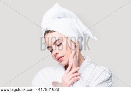 Beautiful Sensual Woman Apply Skincare Cream On Face, Happy Young Woman Wrap Towel On Head Put Facia