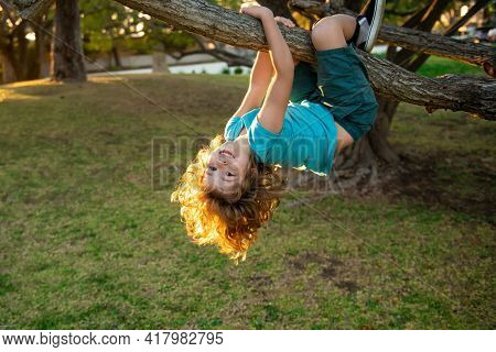 Child Climbing In Adventure Activity Park. Insurance Kids. Health Care Insurance Concept For Kids. M