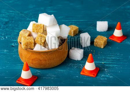Lots Of Granulated Sugar. Sugar In A Wooden Bowl. Traffic Cones, Warning. Excessive Use Of Sugar.