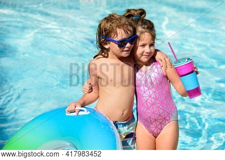 Children In Summer Pool. Summertime Vacation. Kids In Swimming Pool. Friendship. Summer Holidays.