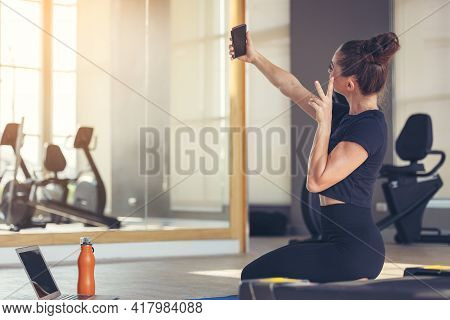 Fitness Woman Taking A Selfie During Workout, Portrait Of Positive Active Sportive Energy Athlete Gi
