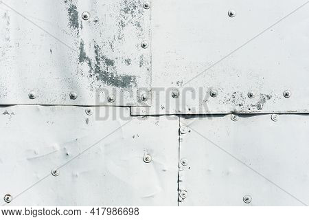 Metal Sheet Texture. Grunge Metal Construction. Connecting Pieces By Bolts. Bolt Heads In Line Backg