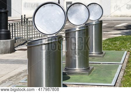 Empty Metal Trash Cans With Open Lids On A City Street
