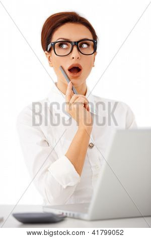Businesswoman wearing glasses suddenly remembering something she had forgotten  raising her eyes with her mouth open  studio portrait