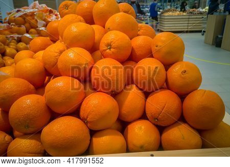 Juicy Oranges For Sale In The Supermarket In The Fruits And Vegetables Section