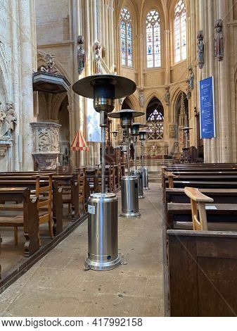 Avioth, France, April 4, 2021 - Gas heater during winter season in a church at Avioth