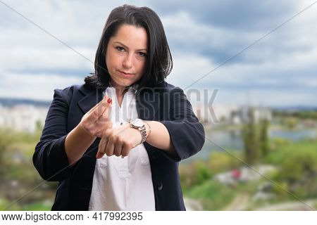 Businesswoman With Serious Expression Wearing Smart Casual Office Suit Making Time Means Money Value