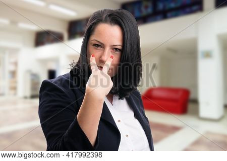 Corporate Businesswoman Wearing Office Suit With Serious Expression Making Eye Contact Gesture Point