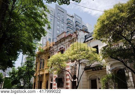 Old Historical Mansions In Neighbourhood To Modern Multi-storey Residential Building. Rise Up Apartm