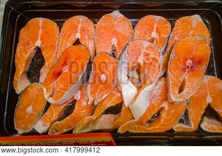 Large Fillets Of Salmon And Trout For Food On Sale In A Hypermarket Among The Ice