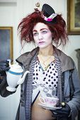 Woman dressed as the mad hatter portrait poster