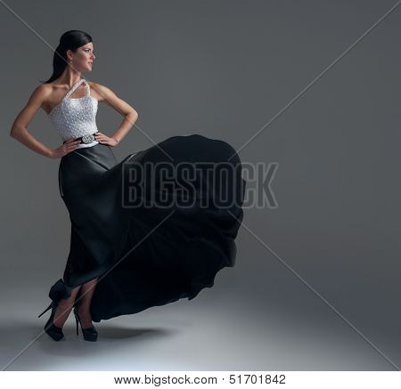 Girl Dances In A Black Silk Skirt