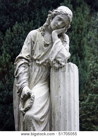 Stone Statue Grieving Woman