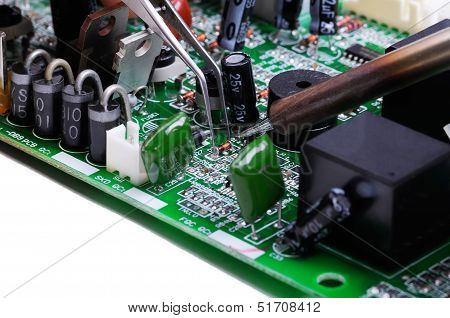Electronic lab working place with soldering iron and circuit board