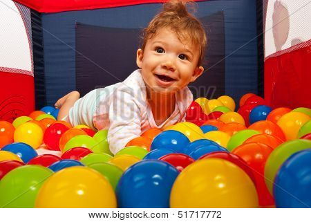 Baby Lying In Colorful Balls