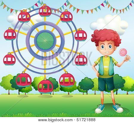 Illustration of a boy holding a lollipop beside a ferris wheel