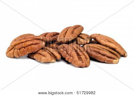 Pecan nuts pile on white background