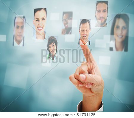 Female finger selecting profile picture on digital interface