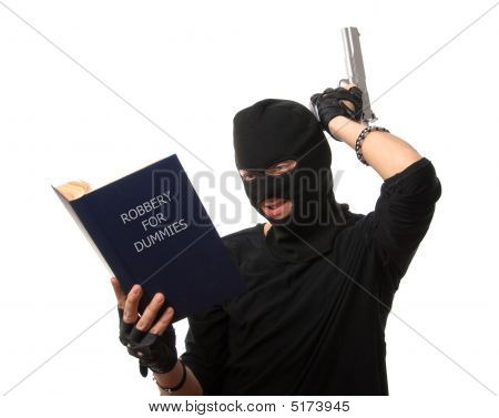 Perplexed Robber With Gun Reads Book Over White.