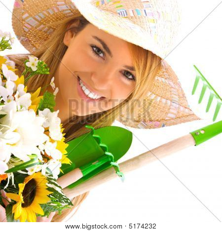 Blond Girl Portrait With Gardening Tools