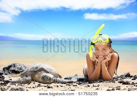 Beach travel woman on Hawaii with sea sea turtle. Snorkeling girl on vacation wearing snorkel smiling happy enjoying blue sky and sun lying next to Hawaiian sea turtles on Big Island, Hawaii, USA. poster