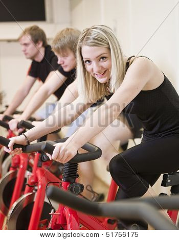 Group of people having class with a girl in focus