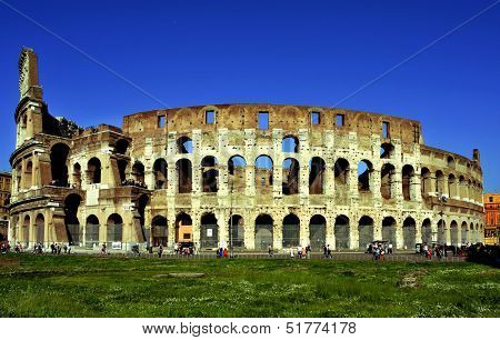 ROME, ITALY - APRIL 17: The Flavian Amphitheatre or Coliseum on April 17, 2013 in Rome, Italy. The Coliseum is an iconic symbol of Rome and one of the most popular tourist attractions in the city