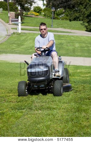 Active Man Mowing;lawn And Landscaping