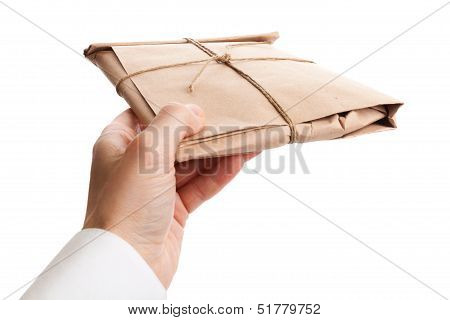 Male Hand Delivers Full Envelope Tied With A Rope Isolated On White Background