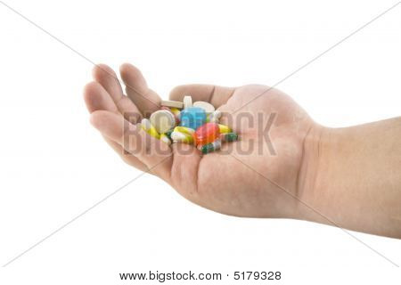 Hand With Pills And Tablets Isolated On White Background