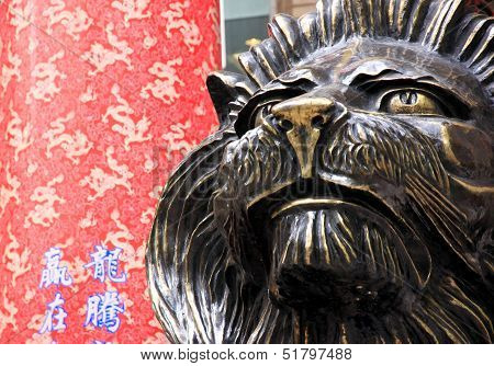 Lion Statue And Traditional Chinese Background