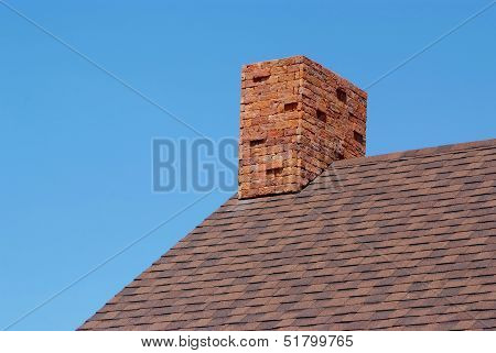 Close Up Brick Chimney On The Roof
