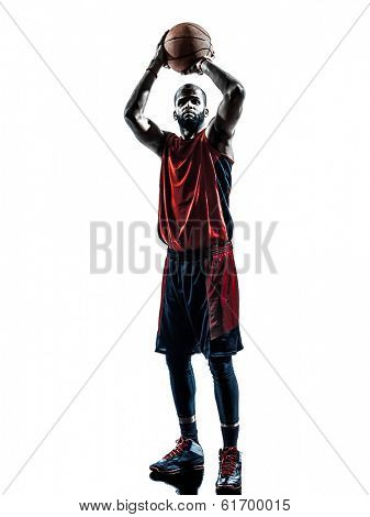 one african man basketball player free throw in silhouette isolated white background