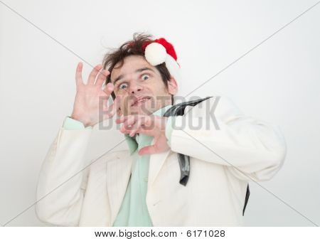 Amusing Man In White Suit And Christmas Cap Is Frightened