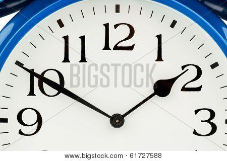 a blue alarm clock on white background. a wake white dial
