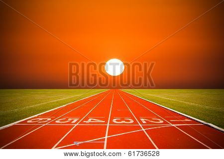 Running track over sunset or sunrise time, Athlete Track or Running Track. Direction very strong.