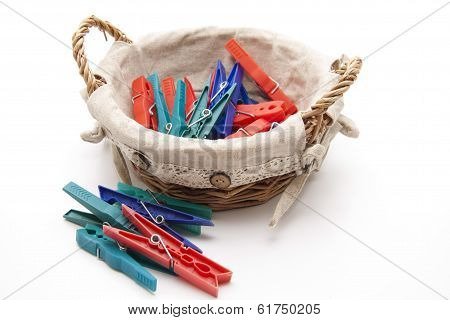 Clothes pegs in the basket