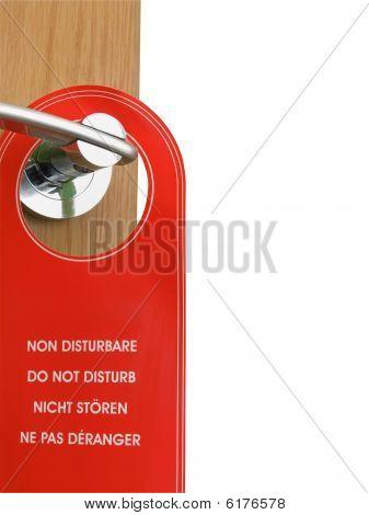 Do Not Disturb Sign Hanging On The Door Handle
