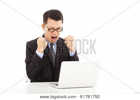 Businessman Making A Fist And Yelling