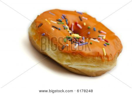 Donut With Orange Frosting And Rainbow Sprinkles
