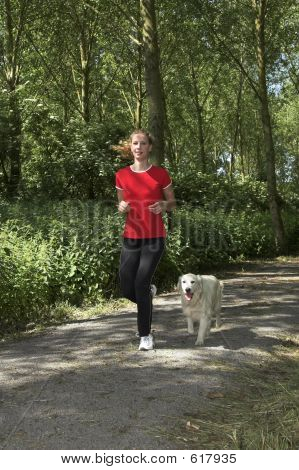 Woman Out For A Run With The Dog