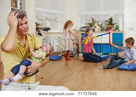 male parent in stress or confusion state of children bad manners behaviour