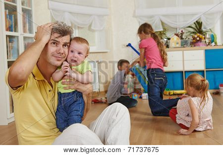 male parent man frustrated and upset from children behaviour